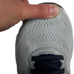 Thumb on the end of the shoe indicating the correct length of a shoe