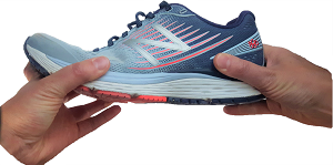 Test the support through the midsole by grabbing either ends of the shoe and twisting or bending the shoe.