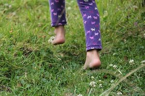 Kids and their feet - Child walking on their toes through the grass