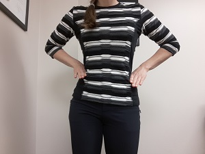 The left hip is lower than the right which causes a leg length discrepancy.