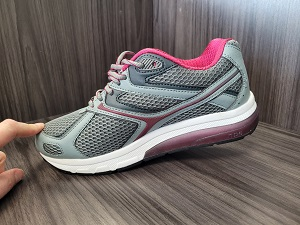 A walking shoe with a rocker sole